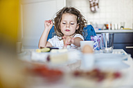 Girl sitting at breakfast table - DIGF000954