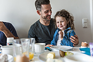 Father and daughter having breakfast together - DIGF000960