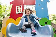 Girl on playground slide - DIGF001011