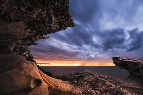 Australia, New South Wales, rock formation and dramatic sky at sunset - GOAF000061