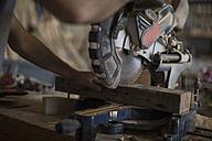 Carpenter working with circular saw in workshop - ZEF009513
