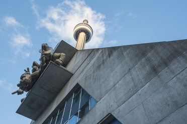 Canada, Ontario, Toronto, Facade of Rogers Center with sculptures, CN Tower, low angle view - FC001036