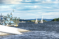 Norway, Oslo, modern art at harbour, moving sailing boats - CST001178
