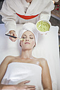 Young woman in spa receiving facial mask - ZEF009552