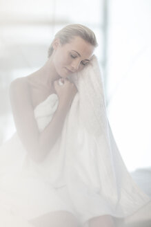Young woman in spa with towel - ZEF009576