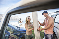 Happy friends with surfboards at the coast - ZEF009624