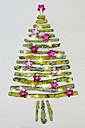Christmas tree shaped of mossy branches and Christmas decoration - GWF004879