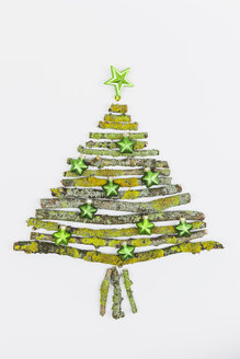 Christmas tree shaped of mossy branches and Christmas decoration - GWF004882