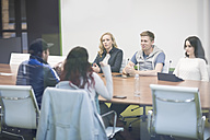 Young people discussing in business meeting - ZEF009771