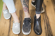 Three people showing their different shoes - ZEF009783