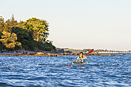 Denmark, Young man kayaking - WDF003726