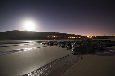 Spain, Galicia, Ferrol, Beach at night with full moon - RAEF001433