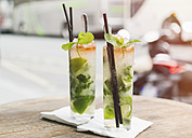 Two glasses of Mojito on table of sidewalk cafe - JUNF000611