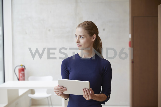 Young woman holding tablet - FMKF003023