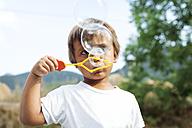 Little boy blowing soap bubbles - VABF000753