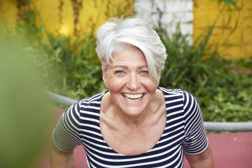 Portrait of happy woman in the garden - FMKF003026