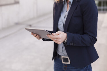 Businesswoman with tablet, partial view - NAF000046