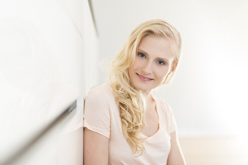 Portrait of smiling blond woman - SHKF000643