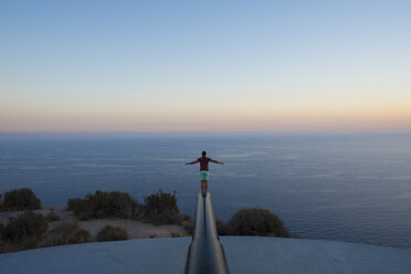 Man on top of a cannon, overlooking the sea - SKCF000179