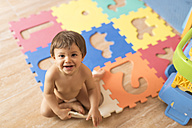 Portrait of baby boy playing in children's room - JASF001101