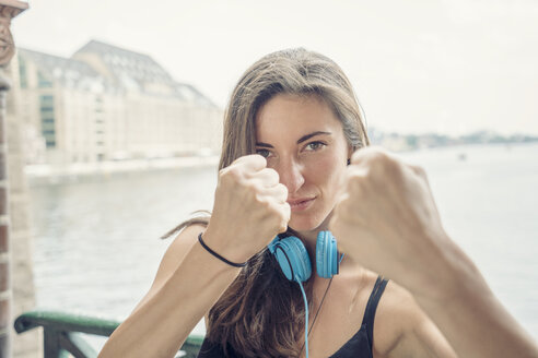 Germany, Berlin, young woman showing fists - TAMF000578