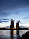 Germany, Lower Saxony, Grohnde, Grohnde Nuclear Power Plant along the Weser river during sunset - HAWF000957