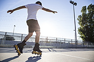 Man with rollerblades during a skating session - ABZF001012