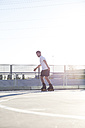Man with rollerblades skating - ABZF001018