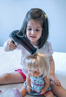 Girl blow-drying hair of doll - DAPF000312