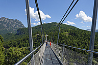 Austria, Tyrol, People standing on supensiion bridge near castle ruin Ehrenberg - LBF001461