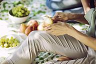 Hands of woman peeling an apple - GDF001111
