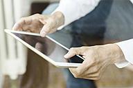 Hands of man using tablet, close-up - SBOF000184