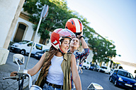 Young couple with motorbike - KIJF000734