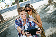 Young couple in love taking selfie with camera - KIJF000743