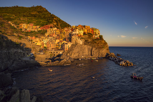 Italy, Manarola, view to the village from seaside at twilight - OPF000130