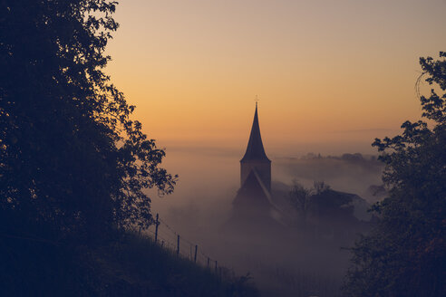 Germany, Weinsberg, church at sunrise, fog - GCF000234