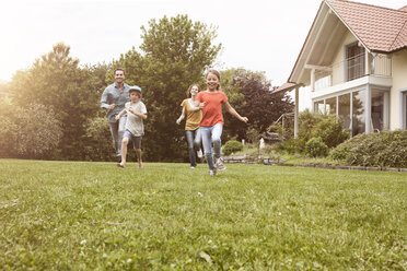 Carefree family running in garden - RBF005121