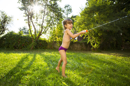 Little girl splashing water with water gun - LVF005232