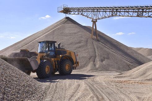 Wheel loader loading gravel in gravel pit - LYF000574