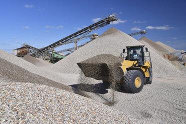 Wheel loader loading gravel in gravel pit - LYF000577