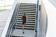 Man running up stairs - DIGF001058