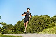 Man running on rural path - DIGF001070