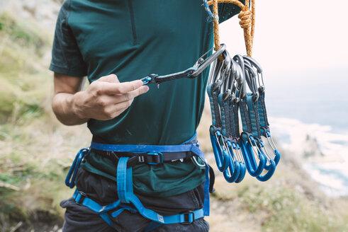 Young man preparing climbing equipment - RAEF001459