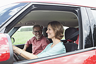 Happy mature couple in car - RBF005153
