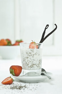 Chia pudding with fresh strawberries and vanilla bean in glass - ASF006017
