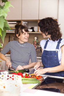 Two friends preparing food in the kitchen - TSFF000102