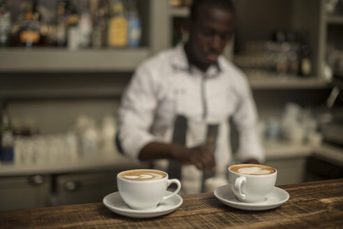 Two cappuccinos on counter of a bar - ZEF010056