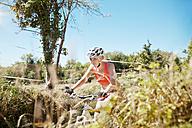 Young woman riding mountainbike - MFF003094