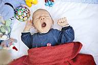 Tired baby in playpen - MFF003139