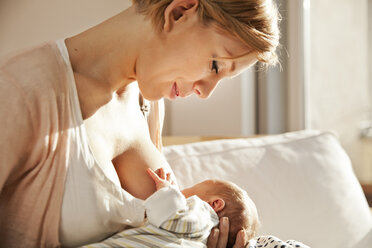 Mother breastfeeding her newborn baby - MFF003181